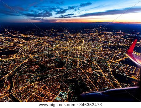 Aerial View Of Moscow, Russia, With Illuminated Streets At Blue Hour - Airplane Engine And Wing With