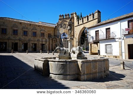 Baeza, Spain - July 28, 2008 - Fountain Of The Lions In The Plaza De Populo With The Villalar Arch A