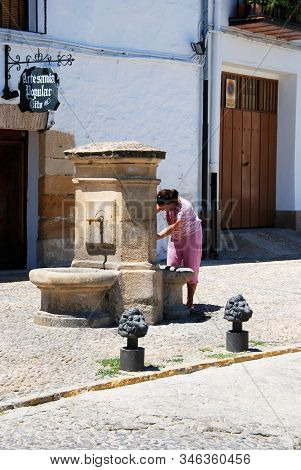 Ubeda, Spain - July 28, 2008 - Girl Taking Water From A Drinking Fountain In The Plaza Santa Lucia,