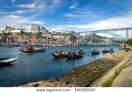 Portugal, City Landscape Porto, Wooden Boats With Wine Port Barrels On Douro River, Panoramic View O