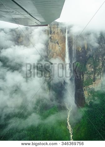 Aerial View Of Angel Falls From Aeroplane Window. Angel Falls Is The Highest Waterfall In The World.