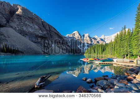 Beautiful View Of Moraine Lake At Sunrise In Rocky Mountains, Banff National Park, Canada.