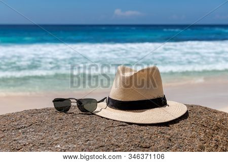 Beach Accessories, Straw Hat And Sunglasses On The Beach