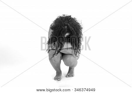 A Fat Plus Plus Size Woman Hugs Herself With Her Arms, Her Head Is Tilted. Hopelessness. The Concept
