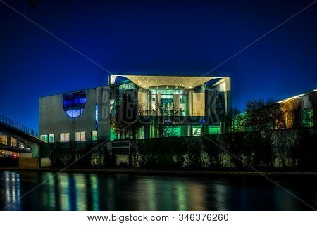 Berlin, Germany - November 17, 2018: The Illuminated Chancellors Office Seen From The River Spree Wi