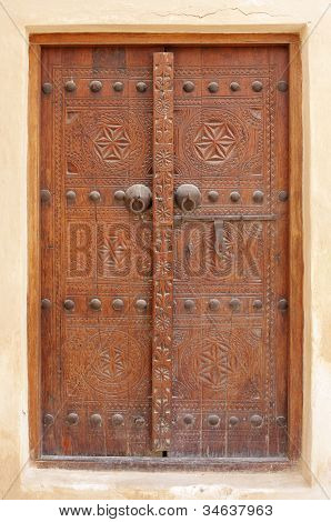 Beautiful ancient carved door with bolts in Riffa fort Bahrain