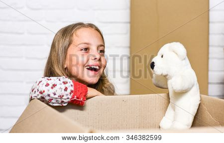 Little Child Open Post Package With Toys. Deliver Your Treasures. Storage For Toys. Delivering Happi