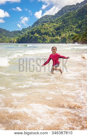 Little Girl Playing In Maracas Bay Beach Trinidad And Tobago Having Fun Splashing In The Waves