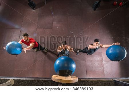 Medicine Ball Workout, Group Of Three Strong Fit Sporty Muscular Man Throwing Medicine Or Med Ball U