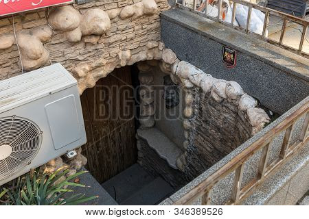 Kutaisi, Georgia, October 13, 2019 : Entrance To The Night Bar Located In The Underground Room On Th