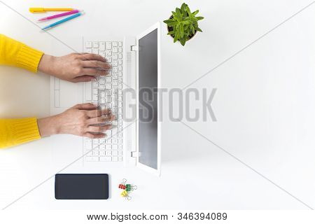 Overhead Shot Of Woman Working On Laptop.