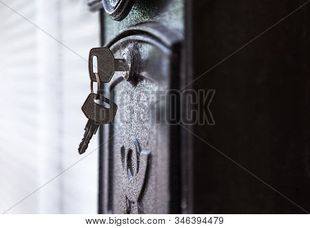 Door Key Inserted In Keyhole Ready To Open Black Metallic Mail Box (letterbox, Mail Slot) Door. Comm