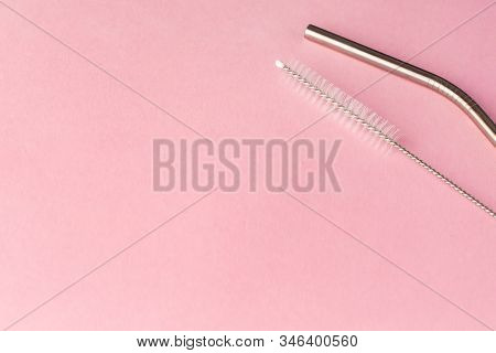 Metal, Bendy Drinking Straw And Steel Cleaning Brush On Pink Background. Aluminum Stainless Reusable