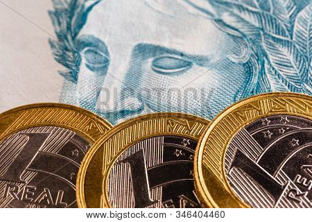 Closeup Of One Real Coin, Money From Brazil. Savings And Savings Coin.