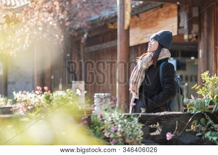 Happy Young Woman Traveler Traveling At The Square Street In Lijiang Old Town, Landmark And Popular