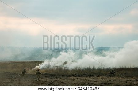 Hostilities. War Concept. Military Training Ground With Explosions. Military Machines. Warriors In C