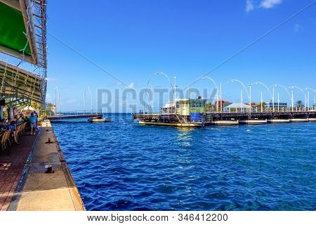 Willemstad, Curacao, Netherlands - December 5, 2019: People At Queen Emma Bridge In Front Of The Pun