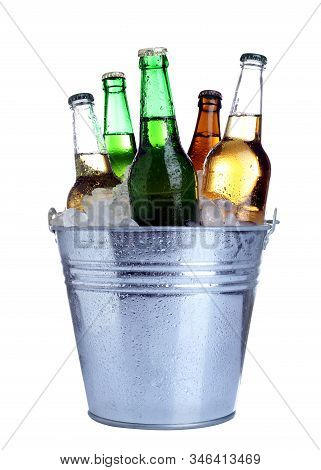 Beer In Metal Bucket With Ice Isolated On White