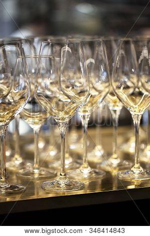 Glasses In The  Restaurant. Glasses Of Wine .gold Glasses .