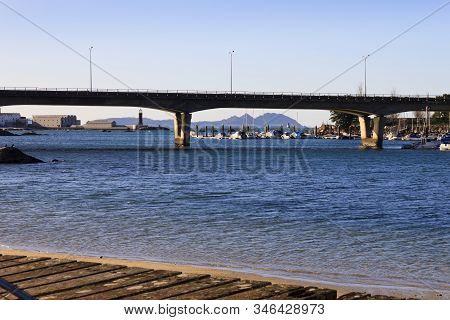 Bouzas Bridge And Marina With Sea Museum And Cies Island On Background In Vigo City, Pontevedra, Spa
