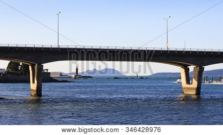 Bouzas Bridge With Sea Museum And Cies Islands On Background In Vigo City, Pontevedra, Spain.