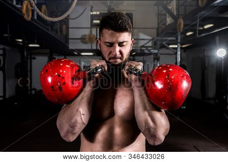Kettlebell Workout, Young Fit Sweaty Muscular Man With Big Muscles Holding Two Big Old Kettlebells W