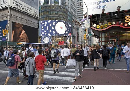 New York, New York/usa - July 2, 2019: Pedestrians Cross Street In Busy Manhattan.