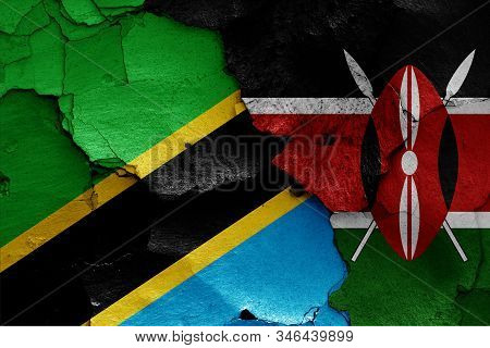 Flags Of Tanzania And Kenya Painted On Cracked Wall