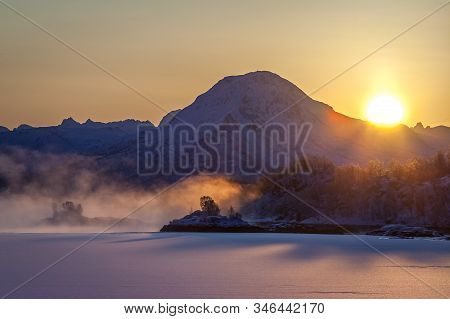 Dramatic Sunrise With Sun In Background And Fog Over Lofoten Islands, Norway. Amazing Dramatic Sunse