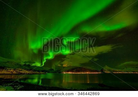 Amazing Polar Lights, Aurora Borealis, Northern Lights Over Fjord Mountains With Many Clouds In The