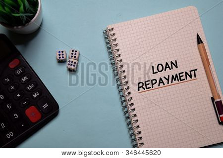 Loan Repayment Write On A Book Isolated On Office Desk.