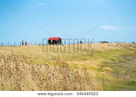 Rye England - August 20 2019; People Walking By Famous Black Shed With Red Roof On Rye Nature Reserv