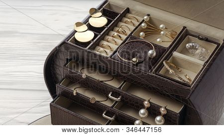 Top View Of Open Brown Leather Jewelry Box. Golden Jewelry In Brown Leather Accessories Box