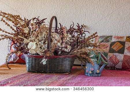 Pictorial Composition Vegetable Basket Cushions Teapot And Frog In A Rustic Genre.