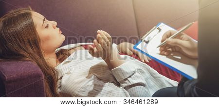 Professional Psychologist Writes Notes While Young Female Patient Talking On Psychotherapy Session,