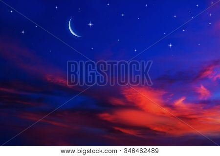 Moon In Bright Clouds Of Sunset Sun . New Moon .  The Sky At Night With Stars.