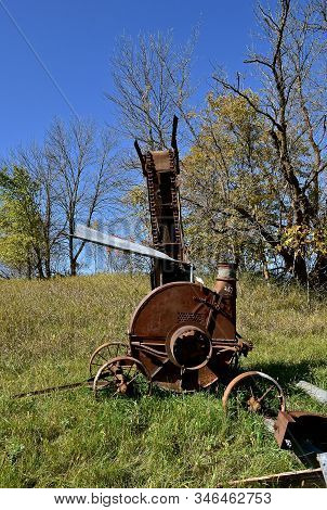 An Old Farm Blower Machine On Portable Wheels Used To Send Silage(chopped Cornstalks) Up Into A Silo