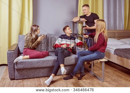 Alcohol Party At Room Of College Dormitory. University Students Drinking Wine In Residence Hall. You