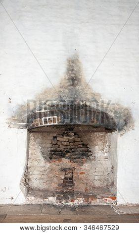 Richmond, Tasmania, Australia - December 13, 2009: Closeup Of Open Fireplace Set In White Wall Of Hi