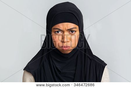 Offence. Closeup Portrait Of Black Muslim Woman In Hijab Pouting, Frowning And Looking At Camera, Po