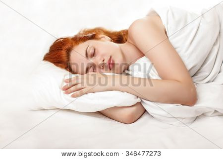 Healthy sleep. A woman is sleeping in the bed. Girl in the bedroom at night. Proper sleep patterns and hormone melotonin