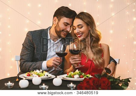 Romantic Dinner. Happy Couple In Love Dating In Restaurant, Celebrating Anniversary Or Valentines Da
