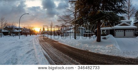 Residential Neighborhood In The Suburbs During A Dramatic Colorful Sunrise