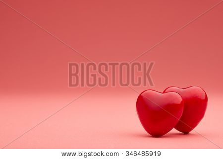 Two decorative hearts on pink background with copy space. Valentine's Day. Wedding Day. Design element for romantic greeting card,  invitation.