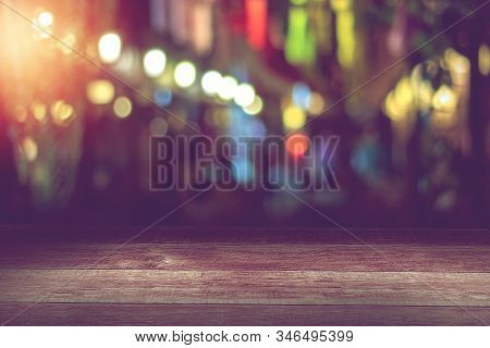 Empty Wooden Table In Front Of Abstract Blurred Night Light Bokeh In Restaurant Background