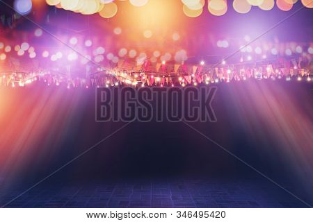 Blurred Bokeh Festival Night Light Of City. Abstract Colourful Evening String Light Bulb Background.