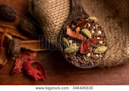 Mix Spices And Herbs In A Wooden Spoon On Dark Background, Indian Spices Food And Cuisine Ingredient