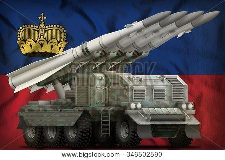 Tactical Short Range Ballistic Missile With Arctic Camouflage On The Liechtenstein Flag Background.
