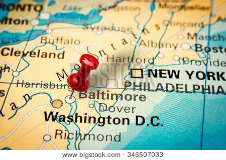 Prague, Czech Republic - January 12, 2019: Red Thumbtack In A Map. Pushpin Pointing At Baltimore Cit