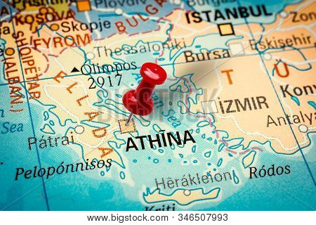 Prague, Czech Republic - January 12, 2019: Red Thumbtack In A Map. Pushpin Pointing At Athens City I